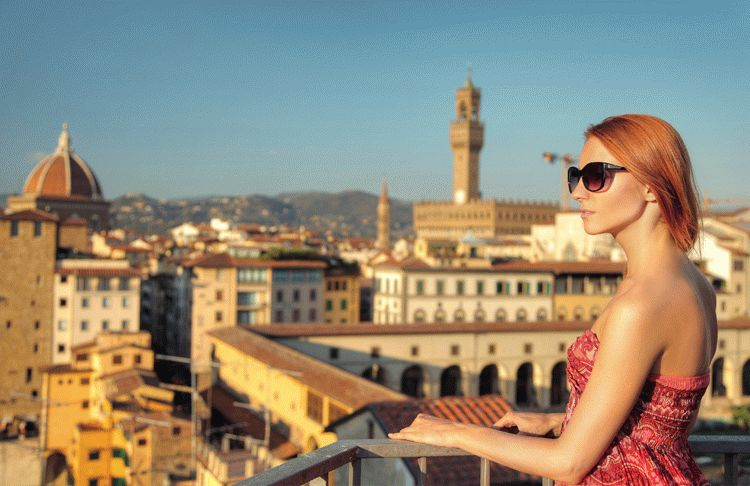 Beautiful woman and view of Florence, Italy